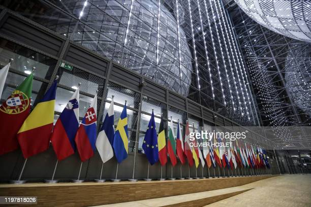 A picture shows a bare flag post amongst flags of the European Union members after the United Kingdom's colours were removed from the European...