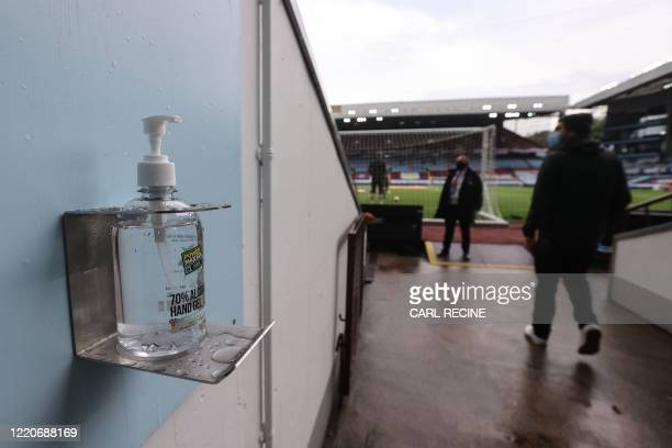 Picture shows a bottle of hand sanitiser at an entrance to the pitch during the English Premier League football match between Aston Villa and...