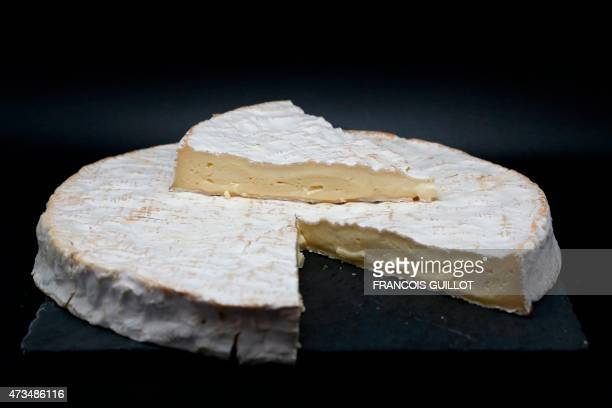 A picture shows a Brie de Meaux cheese displayed in a light box during a Wikicheese photo shoot on May 15 2015 in Paris AFP PHOTO / FRANCOIS GUILLOT