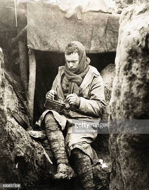 Picture shows a British solider eating his dinner in the trenches during World War I. Undated photo. BPA2# 5602.