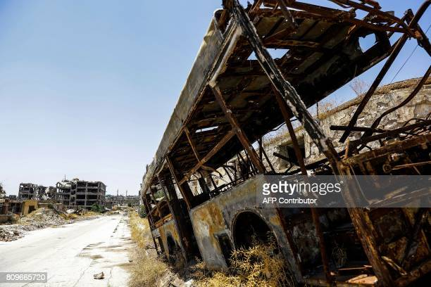 A picture shows a burnt bus in Aleppo's northwest Layramoun industrial district on July 5 2017 Six months after Syria's army captured the country's...