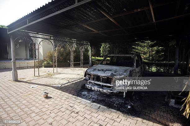 A picture shows a burnt vehicle inside the US consulate compound in Benghazi on September 13 following an attack on the building late on September 11...