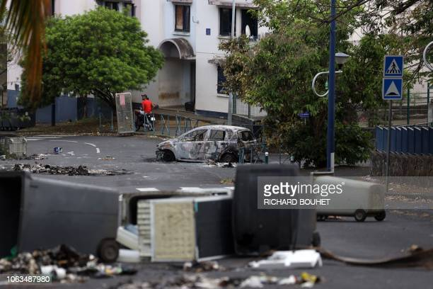 A picture shows a car destroyed after being set of fire overnight on November 18 2018 in the Moufia neighborhood of SaintDenisdelaReunion on the...