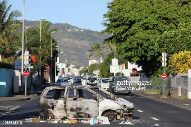 A picture shows a car destroyed after being set of fire overnight on November 20 2018 in SaintDenisdelaReunion on the French overseas island of La...