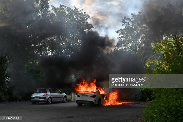 Picture shows a car on fire in the Gresilles area of Dijon, eastern France, on June 15 as new tensions flared in the city after it was rocked by a...