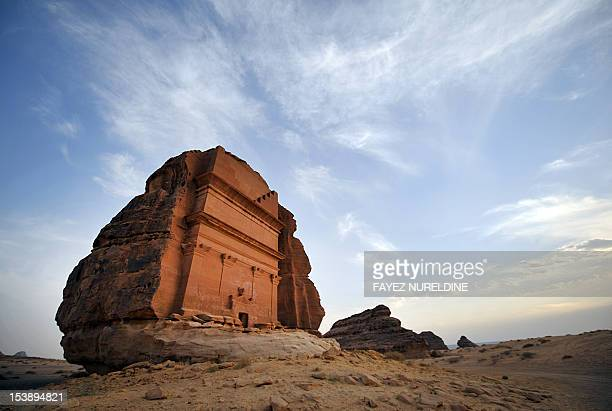 A picture shows a carved rosecoloured sandstone mountains in the Nabataean archaeological site of alHijr near the northwestern town of alUla Saudi...