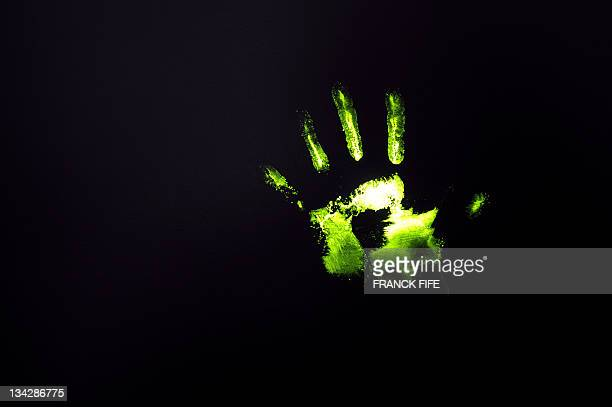 A picture shows a chemical fingerprint which can be seen only under an ultraviolet lighting on November 30 2011 in Paris during the presentation of a...