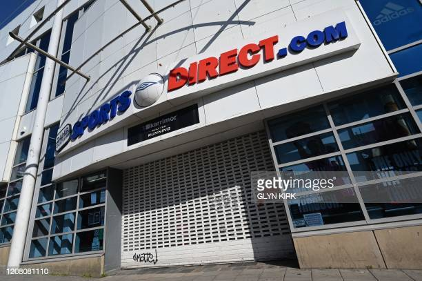 A picture shows a closed branch of the store Sports Direct in Brighton southern England on March 24 2020 after the British government ordered a...