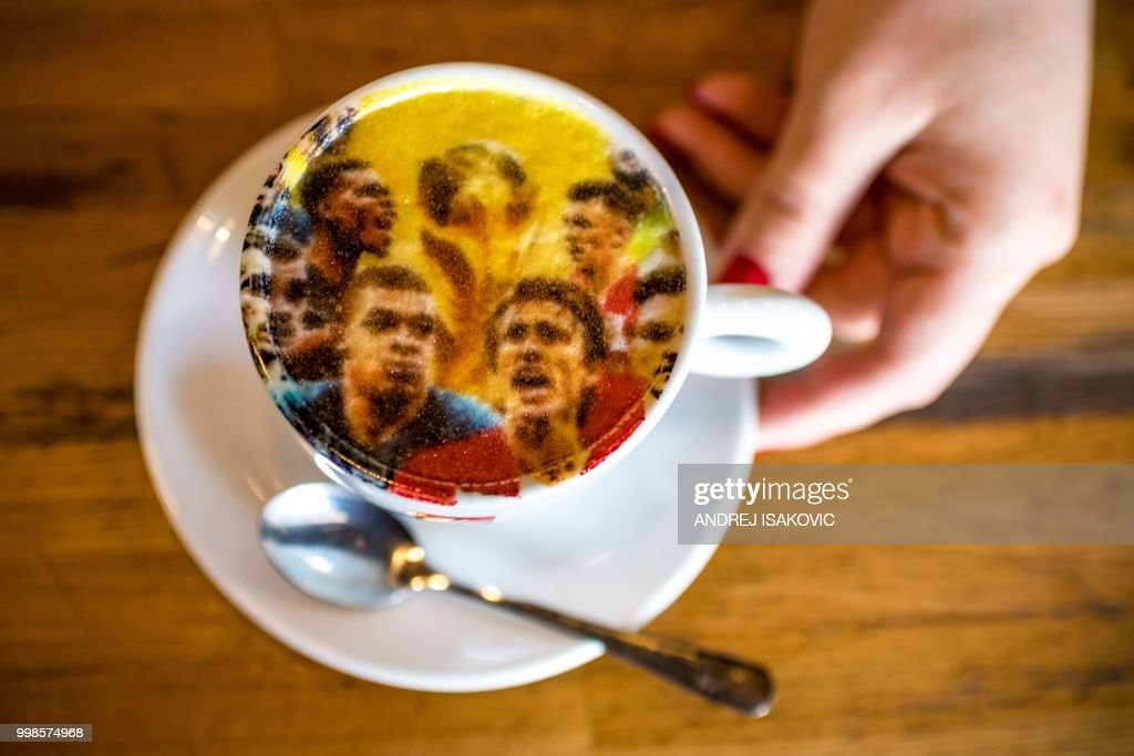 a picture shows a coffee cup covered by a printed image displaying