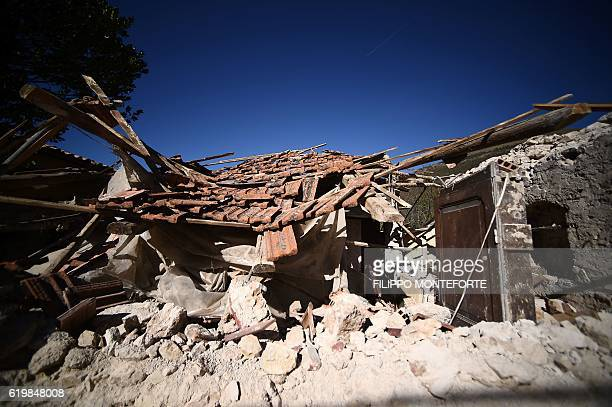 TOPSHOT A picture shows a collapsed house in village of San Pellegrino near Norcia on November 1 two days after a 65 magnitude earthquake hit central...
