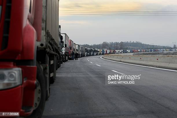 A picture shows a column of lorries blocked on a highway near the Promachonas border crossing between Greece and Bulgaria on February 18 2016 Angry...