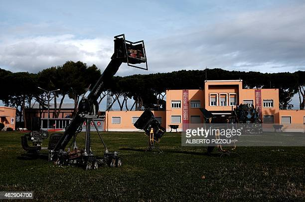 Picture shows a crane and film lighting on February 4, 2015 outside Cinecitta, the famous Italian film studios in Rome. Built during the Fascist era...