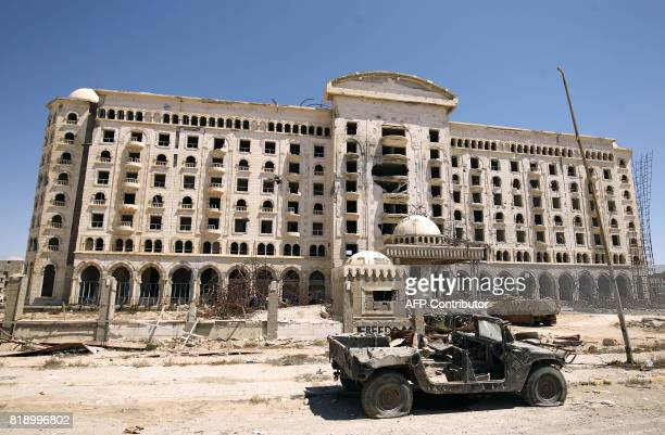 TOPSHOT A picture shows a damaged building in Benghazi's central Akhribish district on July 19 2017 Libyan military strongman Khalifa Haftar on July...