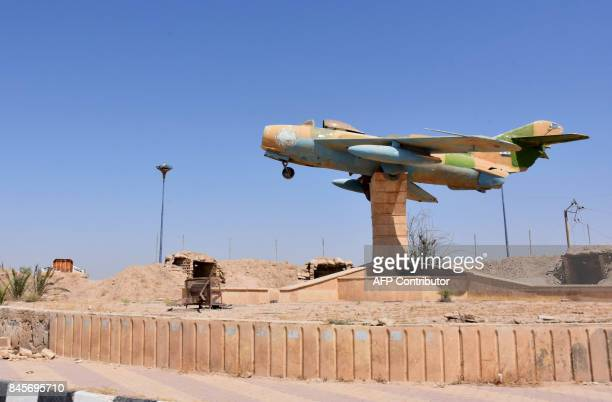 A picture shows a damaged monument at the military airport in the eastern Syrian city of Deir Ezzor on September 11 as Syrian government forces...