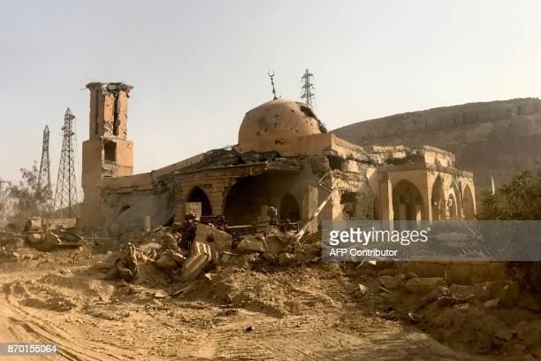 A picture shows a damaged mosque in the eastern Syrian city of Deir Ezzor during a military operation by government forces against Islamic State...