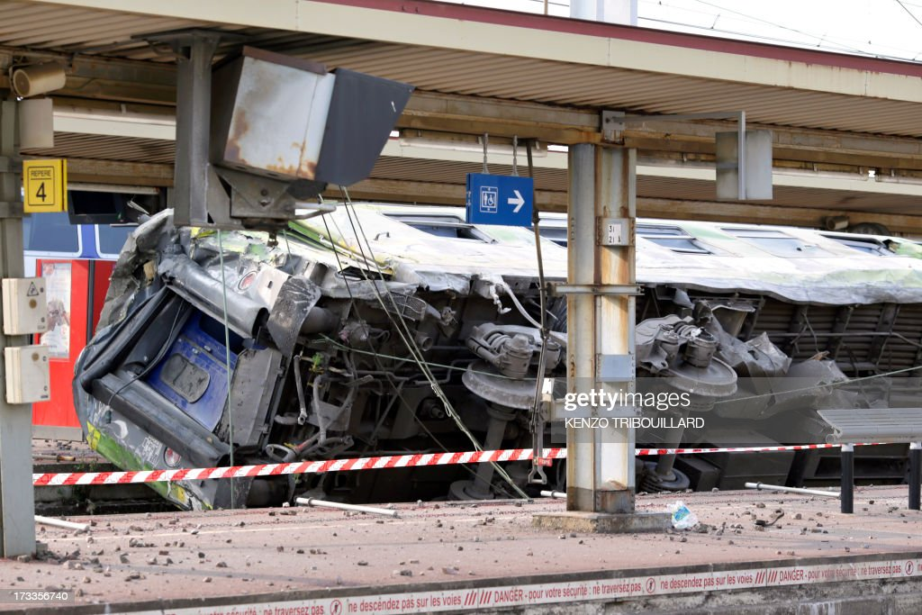 A picture shows a derailed wagon on the site of a train accident in the railway station of Bretigny-sur-Orge on July 12, 2013 near Paris. A train derailed in the Paris suburb of Bretigny-sur-Orge in an accident that caused 'many casualties', authorities said.