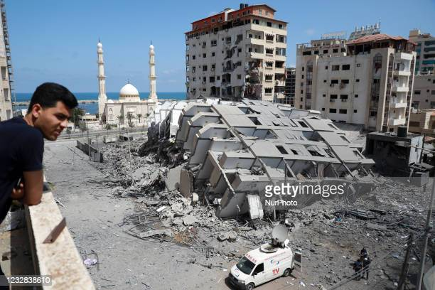Picture shows a destroyed building in Gaza City, following a series of Israeli airstrikes on the Hamas-controlled Gaza Strip early on May 12, 2021. -...