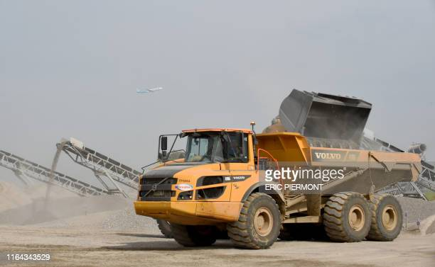 Picture shows a dump truck on construction site of the rebuilding of runway 3 at the Paris-Orly Airport in Orly, south of Paris, on August 27, 2019....