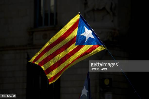TOPSHOT Picture shows a 'Estelada' during a demonstration to support Catalan proreferendum mayors on September 16 2017 in Barcelona More than 700 of...