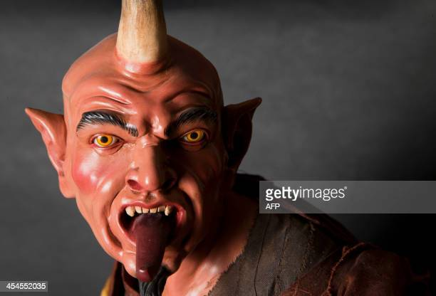 A picture shows a figurine representing the devil at the Scuotto's brothers workshop La Scarabattola which sells crib figurines on December 9 2013 in...