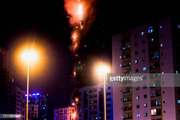 Picture shows a fire that erupted in a 48-storey residential tower in Sharjah in the United Arab Emirates on May 5, 2020.