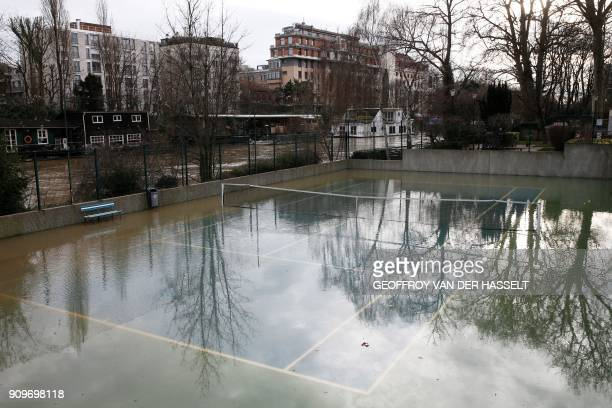 Picture shows a flooded tennis court next to the overflowed River Seine on the Ile de la Grande Jatte between Neuilly-sur-Seine and Levallois-Perret,...