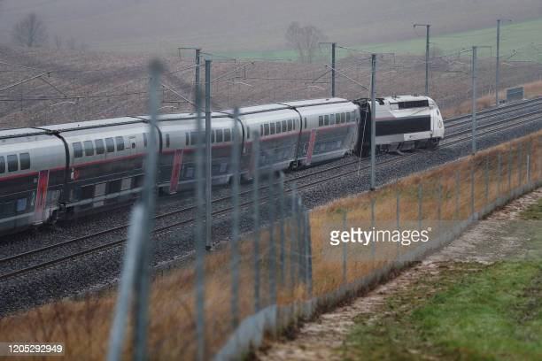 Picture shows a French high-speed TGV train which derailed after an embankment collapsed into the tracks, seriously injuring the driver and hurting...