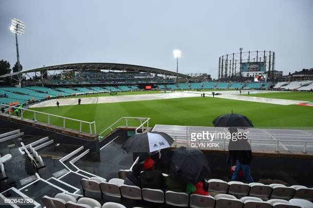 A picture shows a general of The Oval cricket groud as it rains after the ICC Champions Trophy match between Australia and Bangladesh in London on...