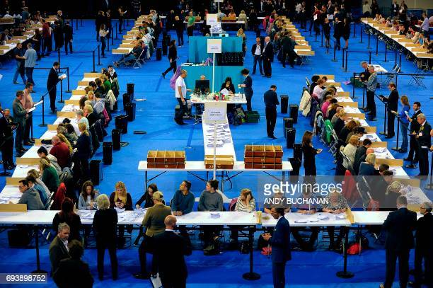 A picture shows a general view as counting staff count ballots at the main Glasgow counting centre in Emirates Arena in Glasgow Scotland on June 8...