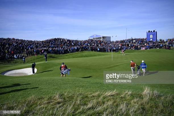 A picture shows a general view during the fourball matches on the second day of the 42nd Ryder Cup at Le Golf National Course at...