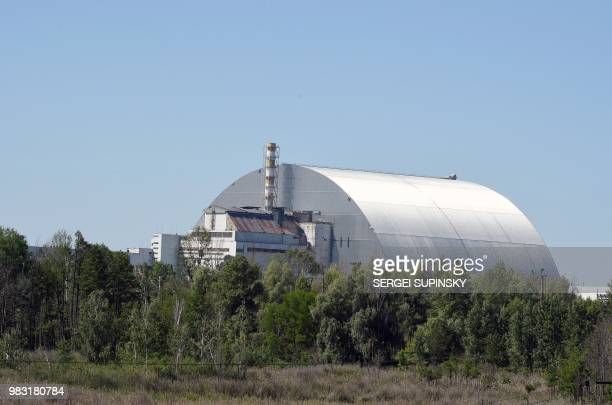 A picture shows a general view of Chernobyl's New 108 metres Safe confinement covering the 4th block of Chernobyl nuclear power plant on June 8 2018...