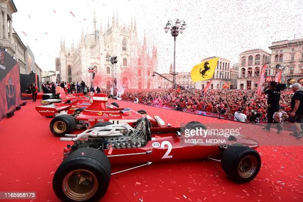 TOPSHOT A picture shows a general view of Ferrari racing cars and Ferrari fans in Piazza Duomo in Milan on Septembre 4 2019 for the presentation of...