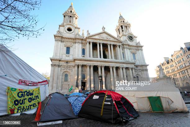 A picture shows a general view of posters and tents forming part of the Occupy London Stock Exchange protest camp site outside St Paul's Cathedral in...