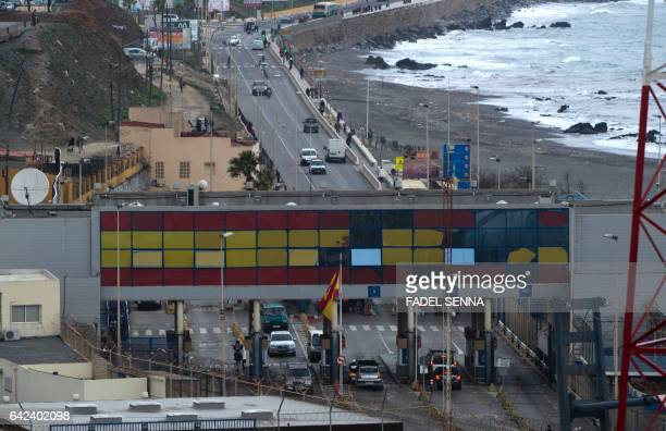 A picture shows a general view of the border between the Moroccan city of Fnideq and the tiny Spanish enclave of Ceuta on February 17 2017 Hundreds...