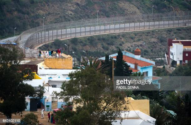 A picture shows a general view of the fence between the Moroccan city of Fnideq and the tiny Spanish enclave of Ceuta on February 17 2017 Hundreds of...