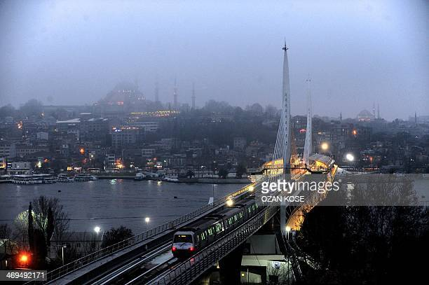 A picture shows a general view of the new metro bridge crossing the Goldern Horn estuary in Istanbul built as part of the SishaneGolden HornYenikapi...