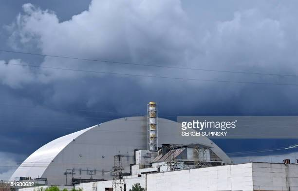 A picture shows a general view of the New Safe Confinement new metal dome designed and built by French consortium Novarka encasing the destroyed...
