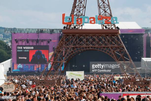 A picture shows a general view with a model of the Eiffel Tower during the Lollapalooza music festival at the Longchamp Hippodrome in Paris on July...