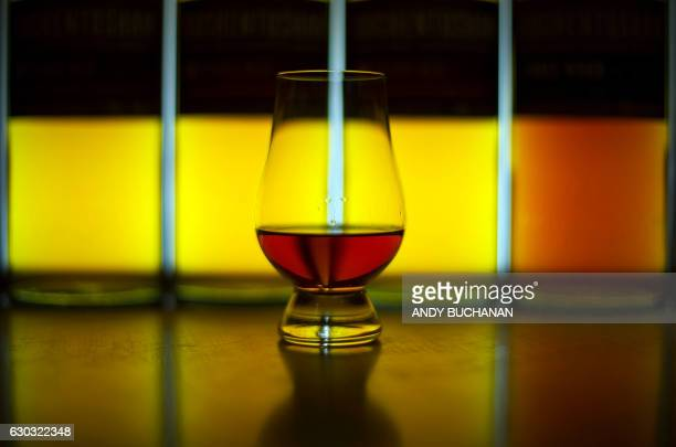 A picture shows a glass of Single Malt whisky produced at the Auchentoshan Distillery a Single Malt whisky distillery on the outskirts of Glasgow on...