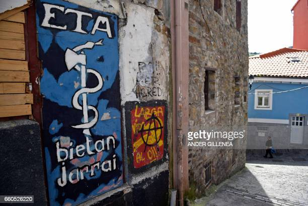Picture shows a graffiti representing the logo of the armed Basque separatist group ETA in the northern Spanish Basque village of Bermeo on March 30...