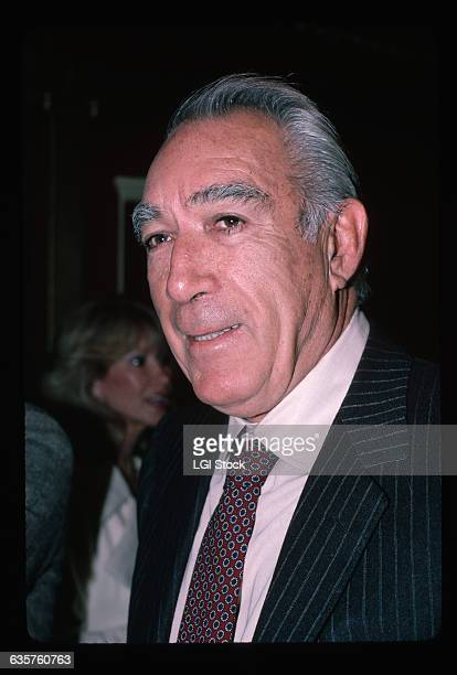 1982 Picture shows a head/shoulders shot of actor Anthony Quinn He is shown wearing a blue pinstriped suit and tie