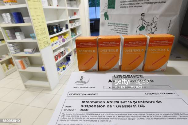 A picture shows a health emergency alert notice next to boxes of Uvesterol D vitamin medication in a pharmacy in Bordeaux southwestern France on...