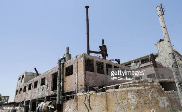 A picture shows a heavily damaged building in Aleppo's northwest Layramoun industrial district on July 5 2017 Six months after Syria's army captured...