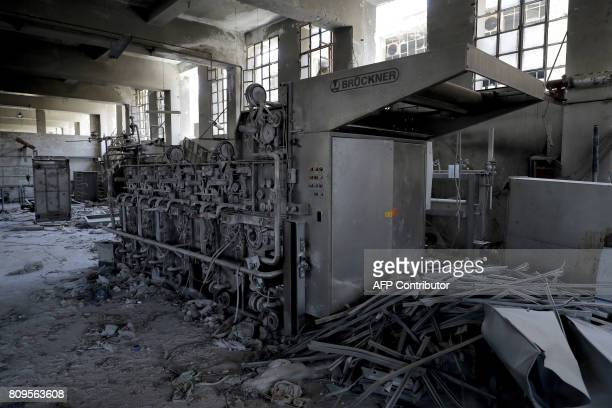 A picture shows a heavily damaged textile factory in Aleppo's northwest Layramoun district on July 5 2017 / AFP PHOTO / JOSEPH EID