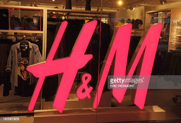 Picture shows a 'Hennes Mauritz' shop taken on October 22 2013 at the Beaugrenelle shopping center in Paris AFP PHOTO ERIC PIERMONT