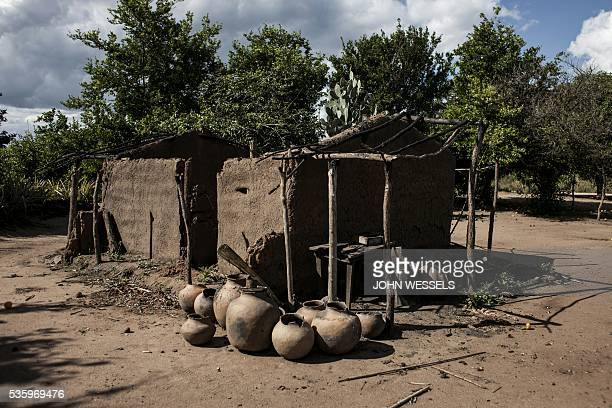 A picture shows a house at the Vanduzi village that has been torched during violence between the Mozambican regular army and the main opposition...