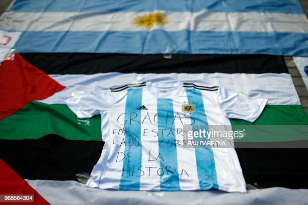 Picture shows a jersey of Argentina's national football team with a text reading 'Thanks for being on the right side of history' as proPalestine...