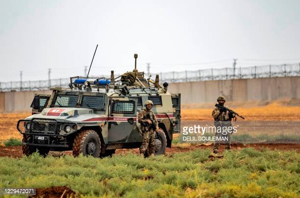Picture shows a joint Turkish-Russian military patrol, in the countryside of the Syrian town of Darbasiyah near the Turkish border in the...