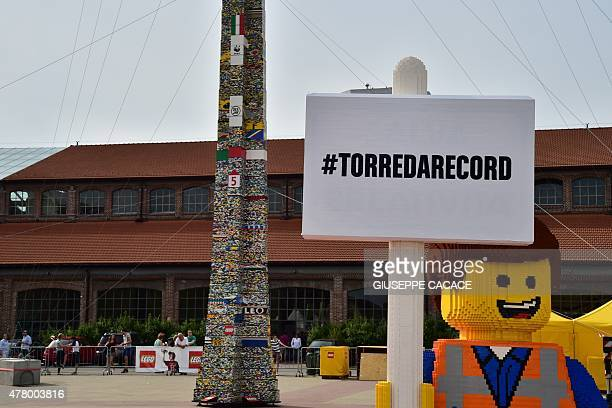 A picture shows a Lego character in front of a 3550 meters high tower of Lego plastic bricks just after the certification by the Guinness World...