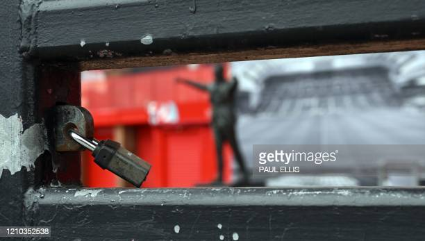 A picture shows a lock on the a gate at Liverpool football club's stadium Anfield in Liverpool northwest England on April 18 2020 Premier League...